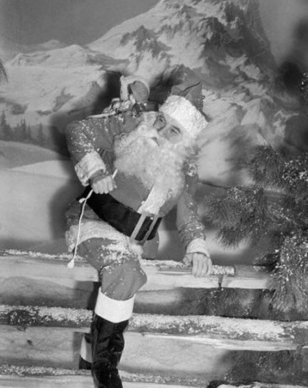 Bela Lugosi as Santa Climbing Over Fence